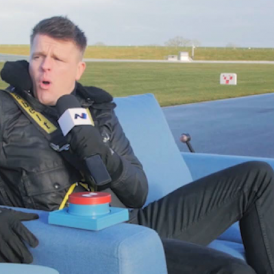 How We Reviewed A Car From A High-Speed Couch
